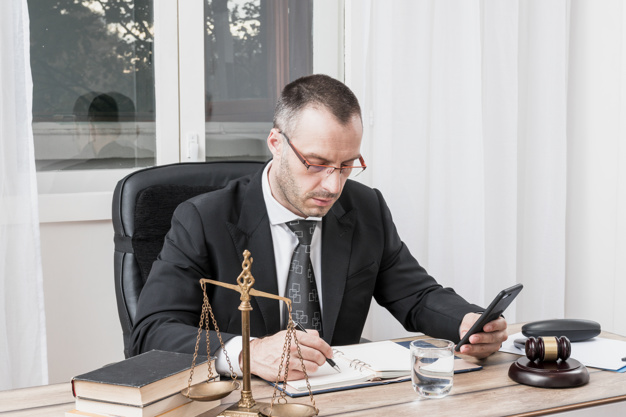 lawyer-with-smartphone_23-2147984045